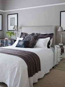 Combine grey wallpaper & curtains with throws & cushions & just add spice